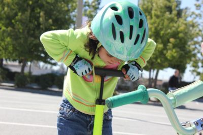 A young rider pumps her tires up. The steps taken in creating a lifelong bike rider, aren't a whole lot different than getting ready to ride yourself.
