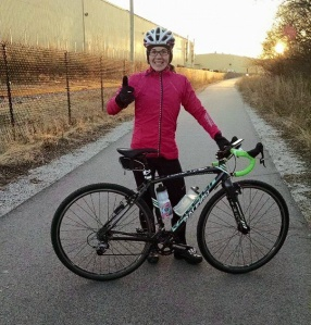 Katie biking in Milwaukee before the warm weather came
