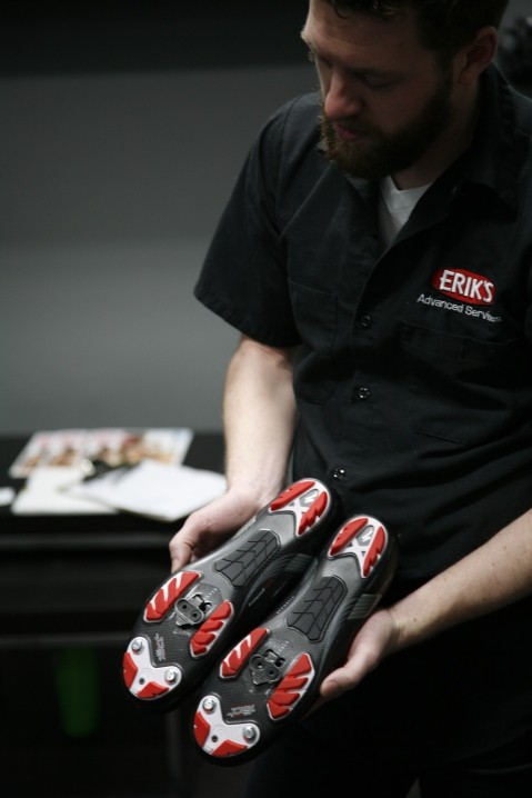 Adjusting cleats as part of a bike fitting.